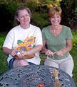 Lisa McCament and Shelly Weis coiling together